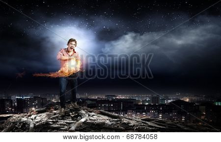 Young man in casual throwing fire ball