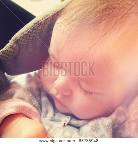 Sweet baby sleeping in baby carrier - With Instagram effect