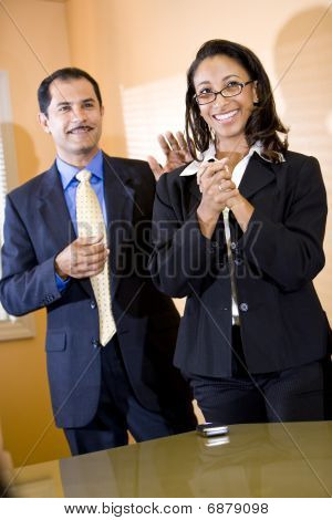 Successful young African American office worker getting pat on back from manager