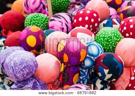 A bunch of colorful fabric balls