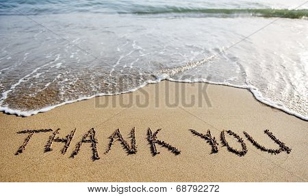 Thank You Word Drawn On The Beach Sand
