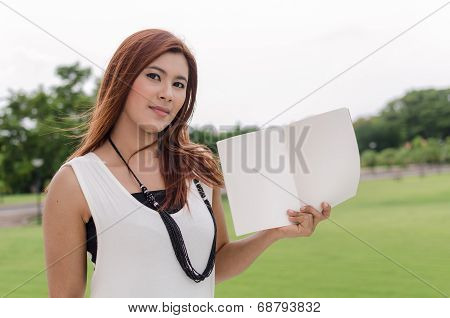 Attractive Young Asian Woman Holding An Open Book