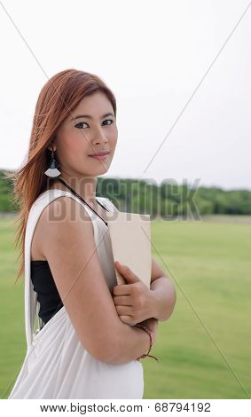 Beautiful Young Asian Woman In The Countryside