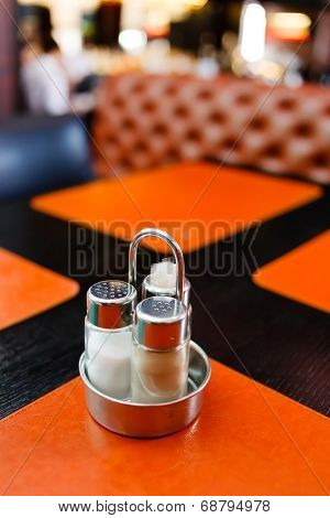 pepper and salt shaker on table at restaurant