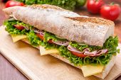 pic of tomato sandwich  - Long Baguette Sandwich with lettuce - JPG