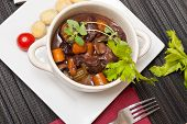 image of boeuf  - Boeuf bourguignon with carrots onions and mushrooms - JPG
