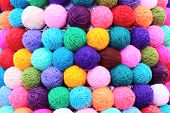 pic of coiled  - background of colored balls of yarn thread - JPG