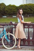 Постер, плакат: Young Beautiful Elegantly Dressed Woman With Bicycle Summer And Lifestyle