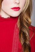 picture of woman red blouse  - closeup of woman face with red lips and white skin and red long hair in a romantic braid - JPG