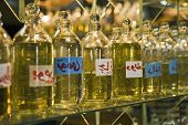 picture of perfume  - Closeup of bottles of essential oils used in perfume making displayed in a row - JPG
