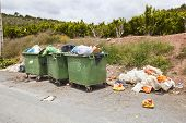 image of valencia-orange  - Overflowing bins next to Orange Orchard - JPG