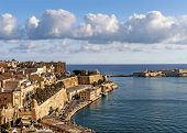 picture of fortified wall  - la valletta old town harbour in malta - JPG