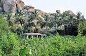 pic of karnataka  - Ancient ruins of Vijayanagara Empire at sunset blue sky in Hampi - JPG