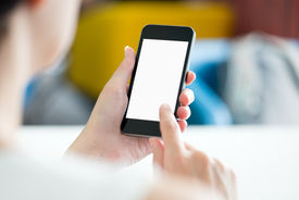 stock photo of touching  - Woman with modern mobile phone in hands touching on a blank screen - JPG