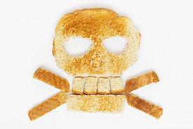 stock photo of skull crossbones  - Stock image of bread skull and crossbones on white background - JPG