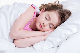 image of nighties  - Adorable little girl in pink nightie sleeps in the bed on a white background - JPG