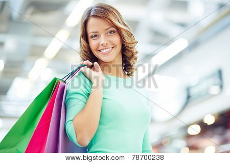 Cute shopaholic with shopping bags
