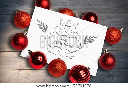 Feliz navidad message against bleached wooden planks background