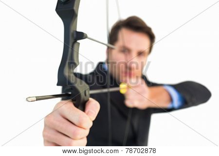 Close up of businessman shooting bow and arrow on white background