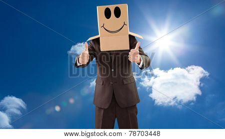 Anonymous businessman with thumbs up against bright blue sky with clouds
