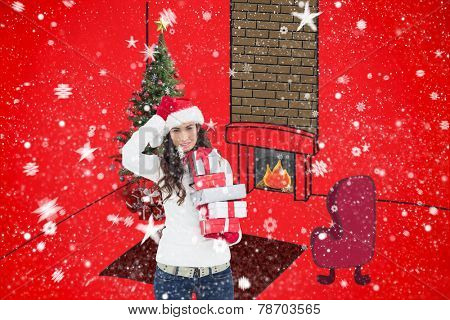 Stressed brunnette in santa hat holding gifts against red background