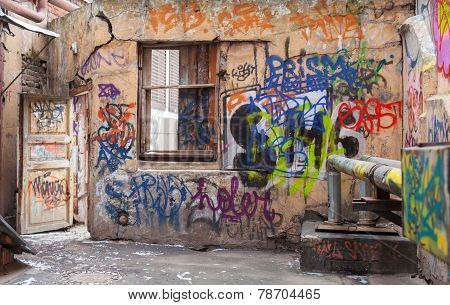 Old Courtyard Walls Painted With Colorful Chaotic Graffiti