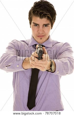 Man In Purple Dress Shirt With Gun Focused On Face.