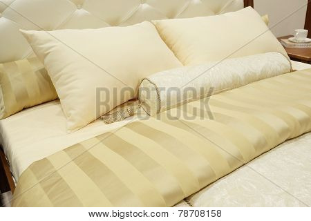 closeup of two pillows and bolster