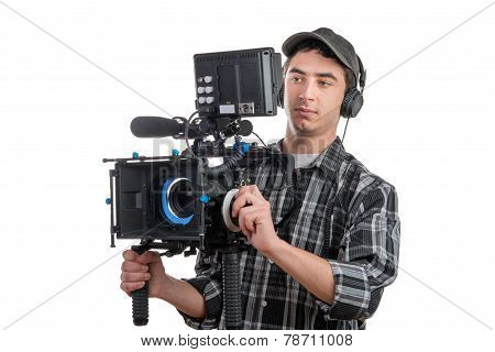 Young Cameraman And Professional Camera