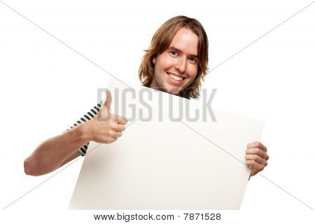 Smiling Young Man With Thumbs Up Holding Blank White Sign
