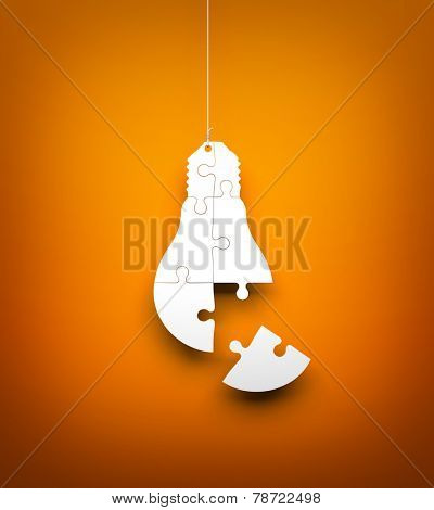Light bulb from puzzles hanging on the rope