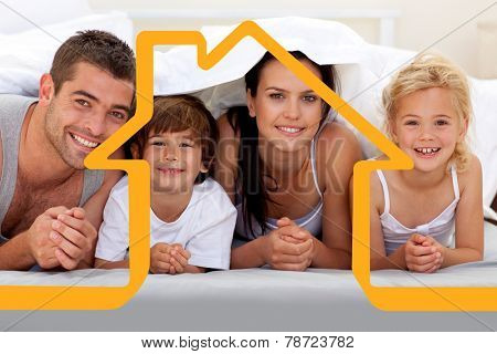 Family playing in parents bed against house outline