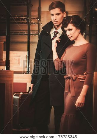 Vintage style couple inside retro train coach