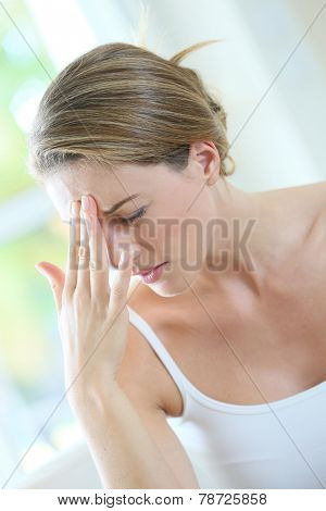 Portrait of woman suffering migraine