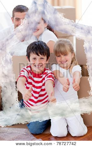 Family moving house with boxes and thumbs up against house outline in clouds