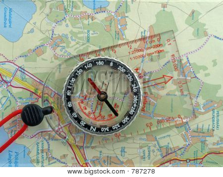 Orienteering compass on a map