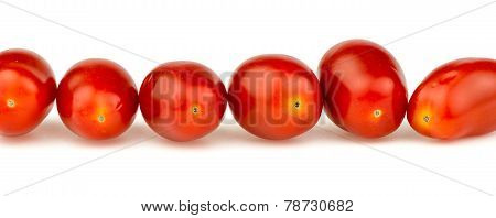 Line Of Natural Organic Red Cherry Grape Tomatoes Isolated On White