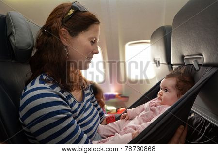 Mother Carries Her Infant Baby During Flight