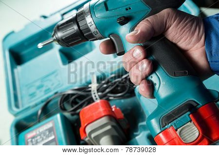 Male Hand Holding A Screwdriver