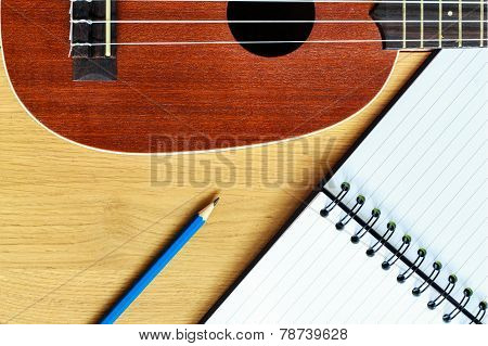 Ukulele Guitar With  Notebook And Pencil