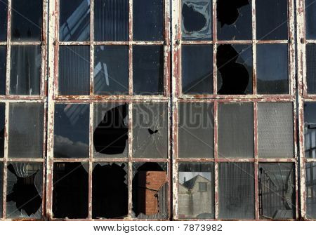 Close Up Of Broken Windows In A Derelict Building.