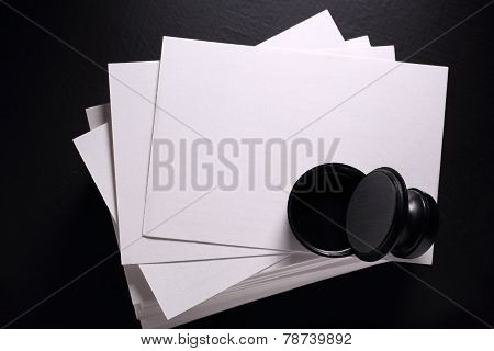 Stack Of Paper Cards And Seal
