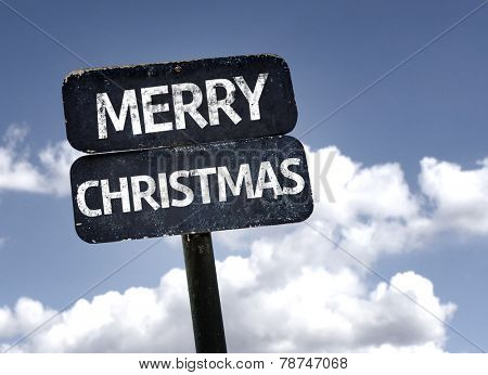 Merry Christmas sign with clouds and sky background