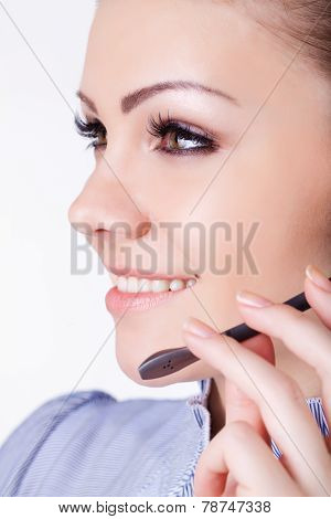 A beautiful woman, the human operator with a headset.