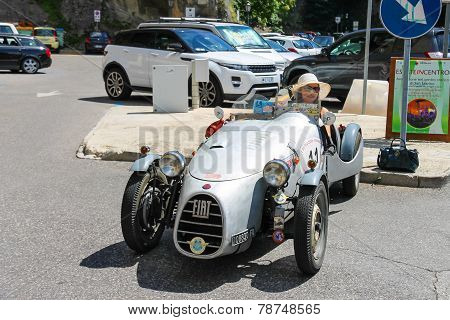 Smiling Woman In Rarity Sports Car In San Marino