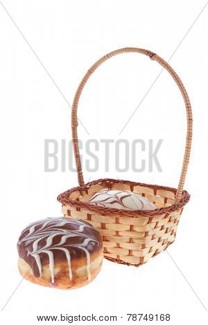 traditional jewish holiday chanuka donuts covered by dark and white chocolate pattern on retro vintage basket isolated on white background