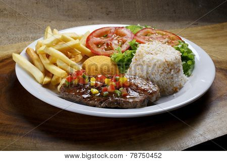 Steak with rice and potatoes