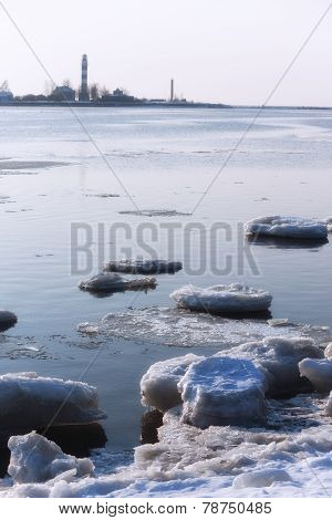 Ice On The River At The Mouth Of The Lighthouse
