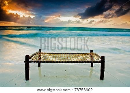 Bed On A Sandy Beach