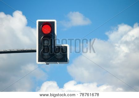 Red Light Traffic Lights Against Blue Sky Background.